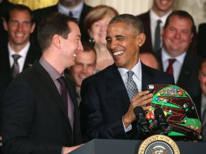 Kyle Busch presents United States President Barack Obama with one of his racing helmets. (photo - NASCAR via Getty Images)
